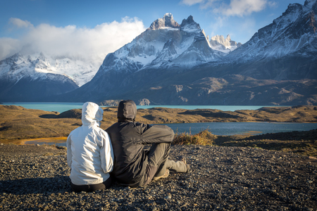 Young couple enjoying the beautiful scenery in Torres del Paine National Park, Patagonia, Chile