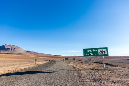 A sign welcoming people in Chile, after the border with Bolivia in the Andes, close to Atacama Desert. Stock Photo