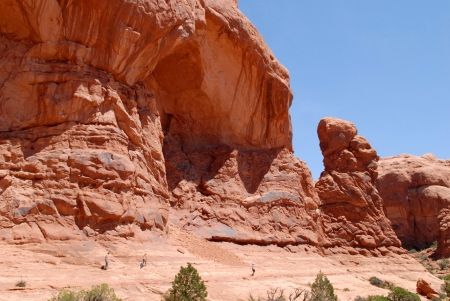 Hikers at Arches National Park in Utah, USA  photo