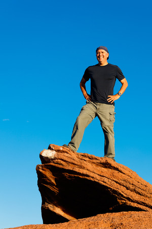 middle age man: Handsome middle age man enjoying the outdoors standing on a sandstone butte at Horseshoe Bend in Arizona.