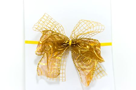 newyears: White gift box with yellow ribbon and bow on white