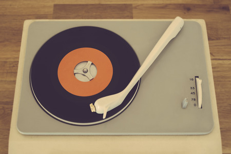 Retro record player from the sixties photo