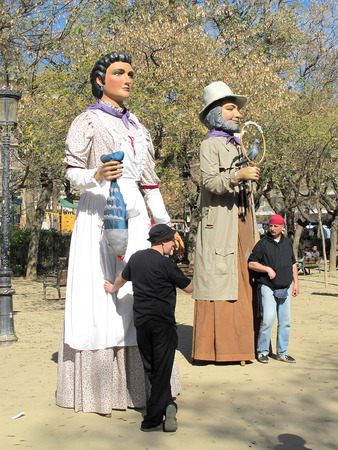 handlers: Giant Puppet Dolls with their handlers
