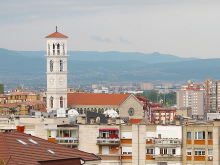 PRISTINA, KOSOVO - JUNE 2016: New Roman Catholic Cathedral of Blessed Mother Teresa with a high bell-tower next to it. Editorial