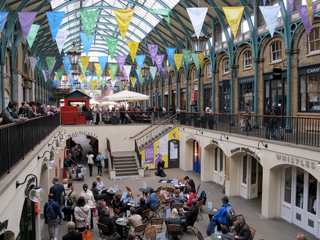 LONDON, ENGLAND - OCTOBER 2014: Covent Garden is one of top 5 shopping destinations and also a great place to eat in London according to various travel advisers.