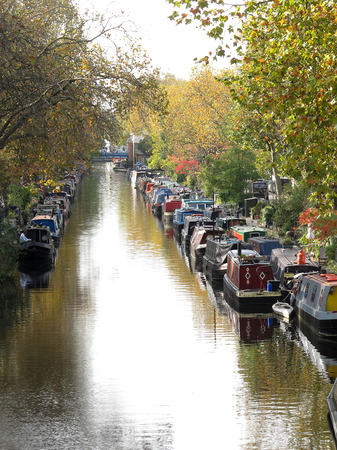 LONDON, ENGLAND - OCTOBER 2014: House boats on the canals in London.