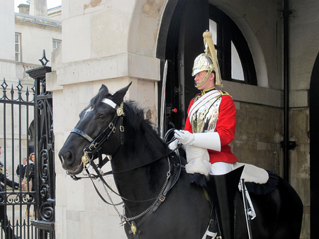 st jamess: LONDON, UK - OCTOBER 2014: The Queen´s Household Cavalry in traditional uniform in St Jamess Park London.