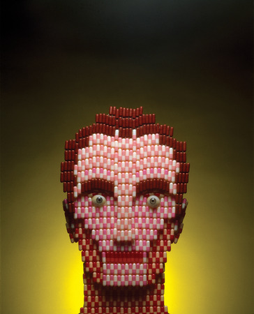 man made: Man made of pills on a yellow background