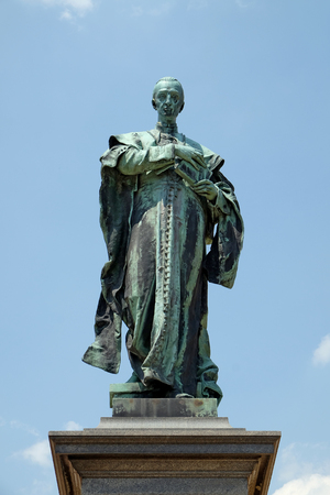 pecs: PECS, HUNGARY - JULY 2015: Statue of Szepessy Ignacz against the blue sky in front of St. Peter and St. Paul Basilica
