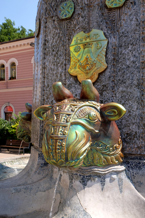 manufactured: PECS, HUNGARY - JULY 2015: Zsolnay manufactured sculptures on a fountain in the main square in Pecs Hungary