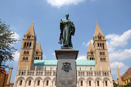 pecs: PECS, HUNGARY - JULY 17, 2015: Statue of Ignasz Szepessy in front of St. Peter and St. Paul Basilica in Pecs on a sunlit summer day.