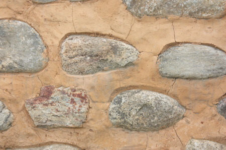 A stone stucco decoration on an ocher wall
