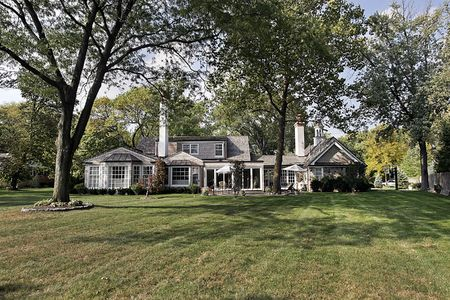 Rear view of shingled luxury home with large lawn Stock Photo - 6732395