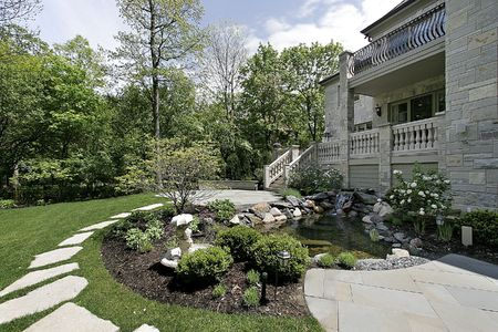 Back yard and patio with stone steps photo