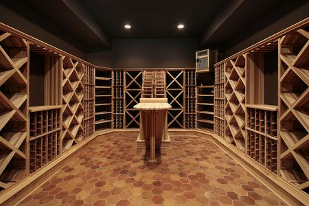 furnishings: Butcher block wine cellar with wood table Stock Photo