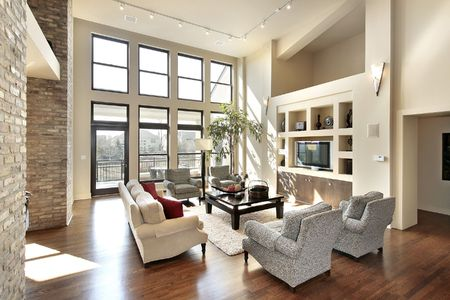 Family room in open floor plan with windows to balcony Stock Photo