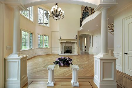 Family room with columns, fireplace and balcony Stock Photo - 6733446