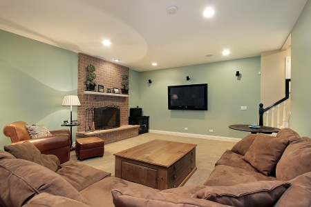Lower level basement with stone fireplace and large screen TV photo