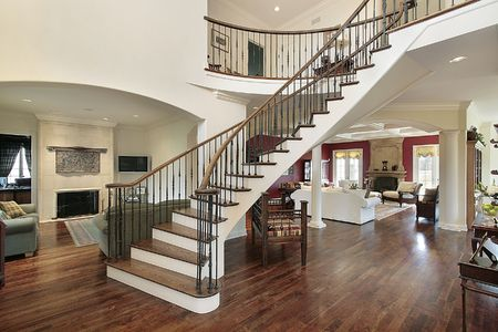 Foyer with staircase and open floor plan photo