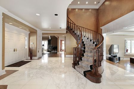 luxury house: Foyer in luxury home with curved staircase