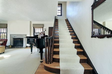 Foyer in suburban home with long stairway