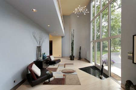 Modern foyer with two story window and sitting area photo