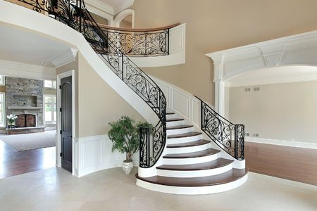 Foyer in new construction home with grand staircase photo