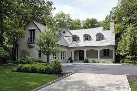 upscale: Front of new construction home with courtyard