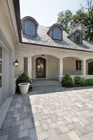 driveways: Close up view of new construction home with stone drive