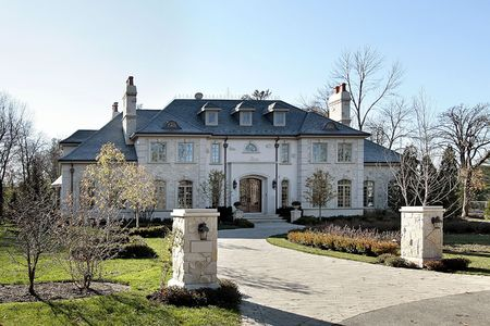 Mansion with circuliar drive and stone pillars photo