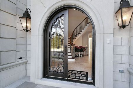 Entry to luxury home with view into foyer photo