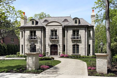 custom home: Luxury stone home with circular driveway and pillars