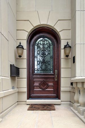 Front door of luxury home with arch photo