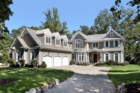 custom home: Luxury new construction home with three car garage Stock Photo