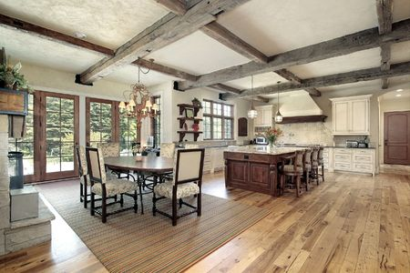Large kitchen with island and ceiling wood beams
