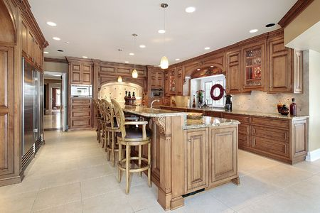 cabinets: Wood cabinet kitchen with large island and arch stove Stock Photo