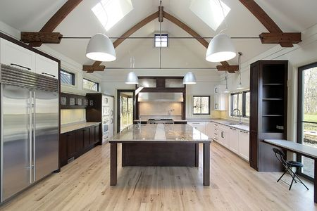 Sleek modern kitchen with large marble island and skylights Stock Photo - 6733275