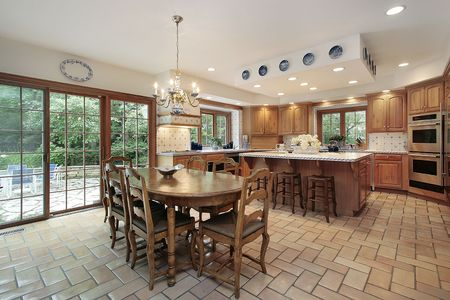 cabinetry: Large kitchen in wood cabinetry with island