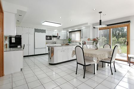 eating area: White kitchen with island and eating area Stock Photo
