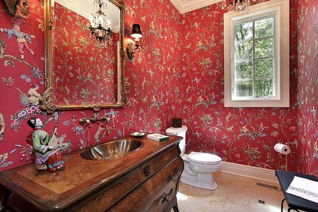 powder room: Powder room in luxury home with red designed walls Stock Photo