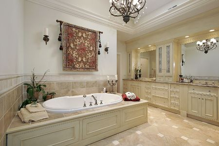 Master bath in luxury home with large tub photo