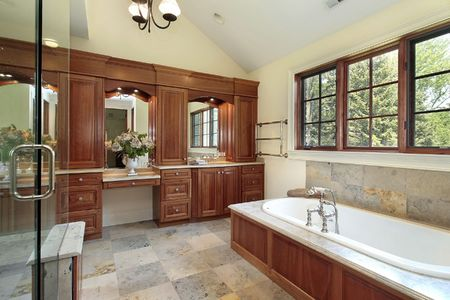 Master bath in luxury home with cherry wood paneling photo