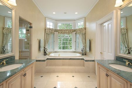 master: Master bath in luxury home with step up tub