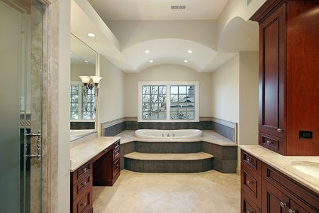Master bath in luxury home with cherry wood paneling Stock Photo - 6732429