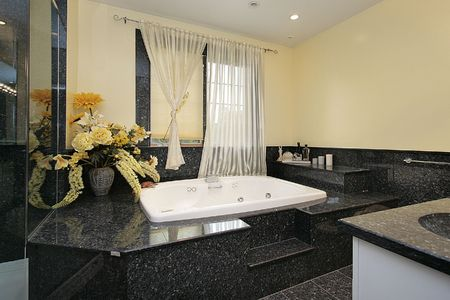 upscale: Master bath in luxury home in back marble