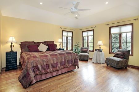 Master bedroom with wood trim window frames photo