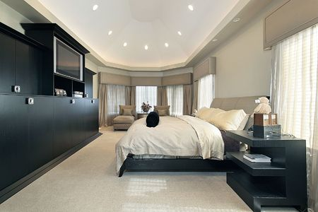 Master bedroom in luxury home with trey ceiling photo