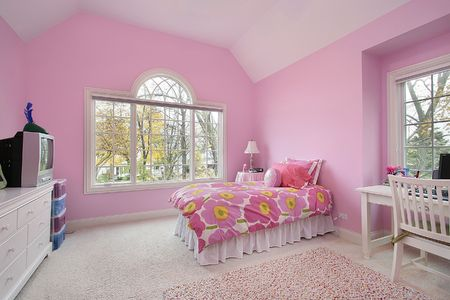 living room sofa: Girls room with pink walls and bed spread