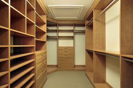 Large master bedroom closet with wood paneling