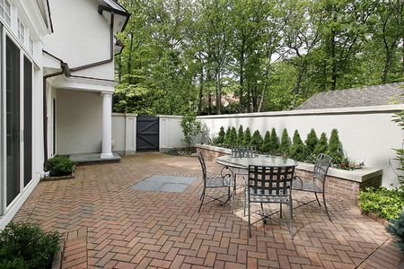Brick patio in luxury home in courtyard photo